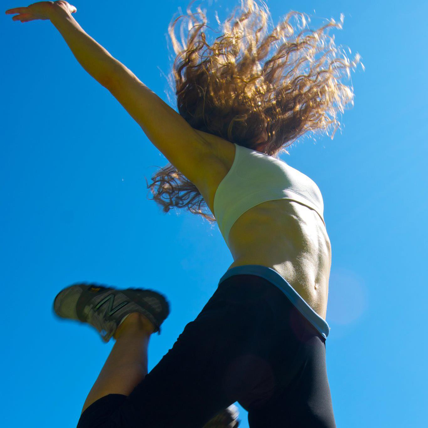 Author Kelly Byrne as Personal Trainer Jumping